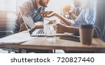 brainstorming process at office.... | Shutterstock . vector #720827440