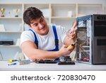 computer repairman repairing... | Shutterstock . vector #720830470