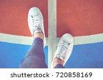 Women's Legs In White Sneakers...