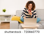 beautiful woman at home sitting ... | Shutterstock . vector #720860770