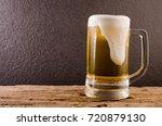 beer in mug on wooden table... | Shutterstock . vector #720879130