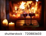 two glasses of red wine near... | Shutterstock . vector #720883603