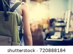 girl with backpack entering to... | Shutterstock . vector #720888184