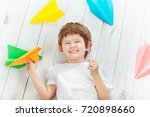 smiling cute child with white t ... | Shutterstock . vector #720898660