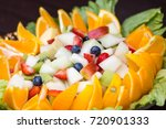 fruit salad in a large glass... | Shutterstock . vector #720901333