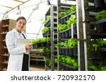 young agricultural expert in...   Shutterstock . vector #720932170