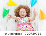 laughing girl play with paper... | Shutterstock . vector #720939793