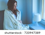 young woman at home sitting... | Shutterstock . vector #720947389