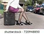 woman sitting on the travel bag ... | Shutterstock . vector #720948850