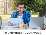 outdoor closeup of good looking ... | Shutterstock . vector #720979018