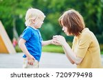 mother comforting her crying... | Shutterstock . vector #720979498