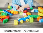 closeup of child's hand with... | Shutterstock . vector #720980860