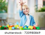 adorable little boy playing... | Shutterstock . vector #720980869