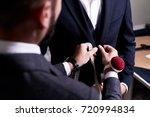over shoulder view of bearded... | Shutterstock . vector #720994834