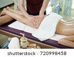 unrecognizable man massaging... | Shutterstock . vector #720998458