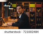 young entrepreneur working on... | Shutterstock . vector #721002484