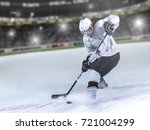 ice hockey player in action... | Shutterstock . vector #721004299