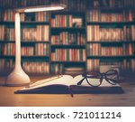 office desk with led lamp cup... | Shutterstock . vector #721011214