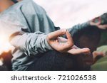 young woman practicing yoga on... | Shutterstock . vector #721026538