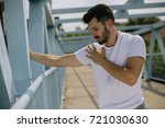 young sportsman stretching... | Shutterstock . vector #721030630