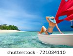 woman traveler sit at the stern ... | Shutterstock . vector #721034110