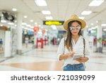 happy women tourist on tablet... | Shutterstock . vector #721039099