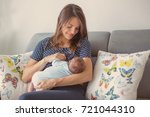 young mother breastfeeding  her ... | Shutterstock . vector #721044310