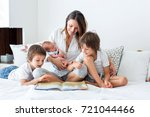 young mother  read a book to... | Shutterstock . vector #721044466