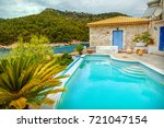 swimming pool on island of... | Shutterstock . vector #721047154