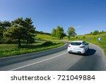 cars driving on the asphalt... | Shutterstock . vector #721049884