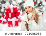 beautiful woman with christmas... | Shutterstock . vector #721056058