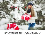 beautiful woman with christmas... | Shutterstock . vector #721056070