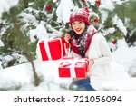 beautiful woman with christmas... | Shutterstock . vector #721056094