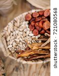 Small photo of food, healthy lifestyle, gourmet kitchen concet. close up of wickerwork picnic hamper with different delicious snakes such as pistachio nuts, dried apricots and bean sprouts