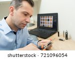 man cutting a vape refill... | Shutterstock . vector #721096054