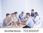 young happy coworkers talking... | Shutterstock . vector #721101019