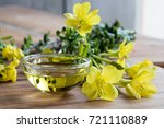 evening primrose oil in a glass ... | Shutterstock . vector #721110889