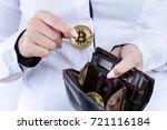 businesswoman holding bitcoin... | Shutterstock . vector #721116184
