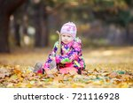 little girl playing with toy... | Shutterstock . vector #721116928