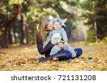 young woman and daughter... | Shutterstock . vector #721131208