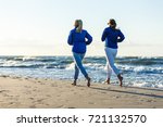 middle aged woman running on... | Shutterstock . vector #721132570