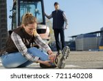 woman having a sprain at work | Shutterstock . vector #721140208