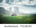 Tractor Fertilizes Crops In Th...