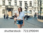 young brunette woman walking... | Shutterstock . vector #721190044