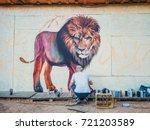 graffiti artist painting on the ... | Shutterstock . vector #721203589
