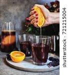 hand squeezing blood orange... | Shutterstock . vector #721215004