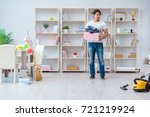 man doing cleaning at home | Shutterstock . vector #721219924