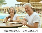 amusing old couple at cafe table | Shutterstock . vector #721235164