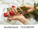 Red Rose In Senior Woman Hands...