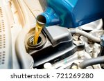 refueling and pouring oil into... | Shutterstock . vector #721269280